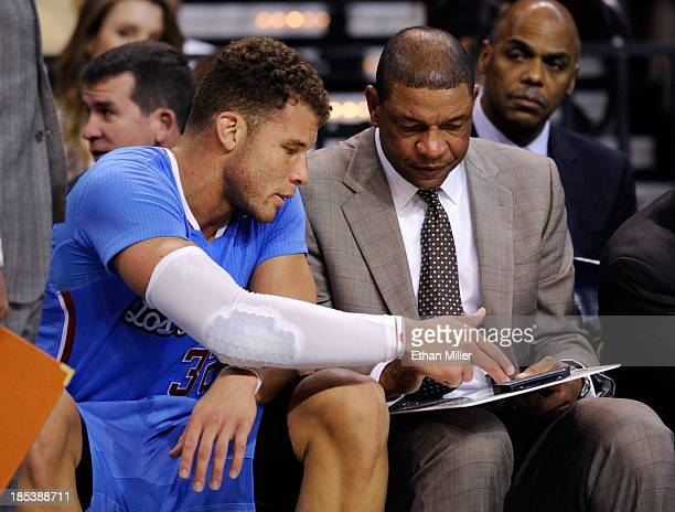 Blake Griffin and head coach Doc Rivers of the Los Angeles Clippers talk on the bench during their preseason game against the Denver Nuggets at the...