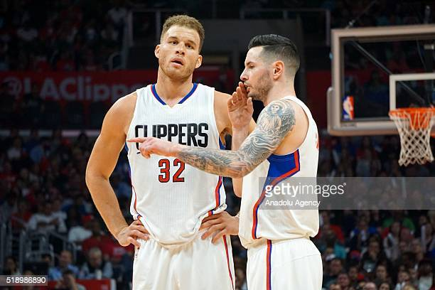 Blake Griffin and JJ Redick of LA Clippers gesture during an NBA game between Los Angeles Clippers vs Washington Wizards at Staples Center Los...