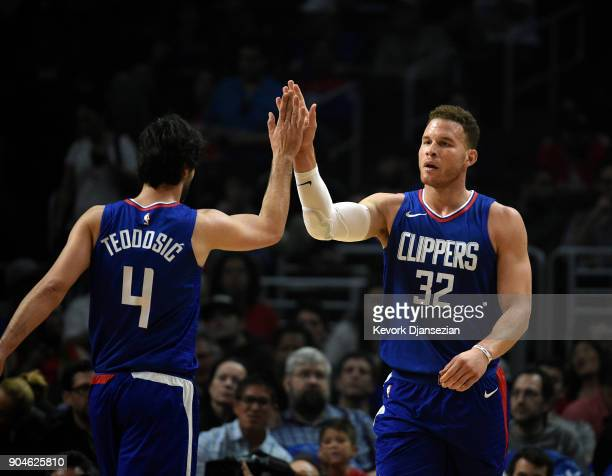 Blake Griffin and Milos Teodosic of the Los Angeles Clippers high five during the first half against Sacramento Kings at Staples Center on January 13...