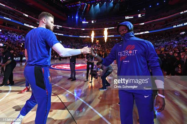 Blake Griffin and Reggie Jackson of the Detroit Pistons high five before Game Four of Round One against the Milwaukee Bucks during the 2019 NBA...