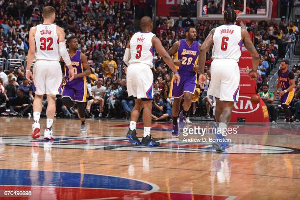 Blake Griffin Chris Paul and DeAndre Jordan of the LA Clippers looks on during the game against the Los Angeles Lakers on April 1 2017 at STAPLES...