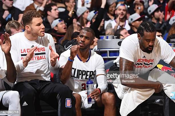 Blake Griffin Chris Paul and DeAndre Jordan of the LA Clippers show emotion on the bench during the game against the Toronto Raptors at STAPLES...