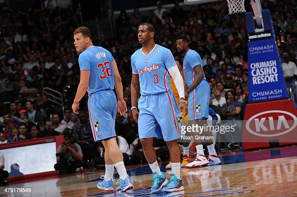 Blake Griffin Chris Paul and DeAndre Jordan of the Los Angeles Clippers stand on the court during a game against the Cleveland Cavaliers at Staples...
