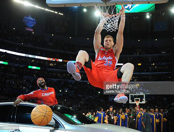 Blake Griffin from the LA Clippers slam dunks a ball over a car as teammate Baron Davis looks on before winning the AllStars Slam Dunk contest at the...