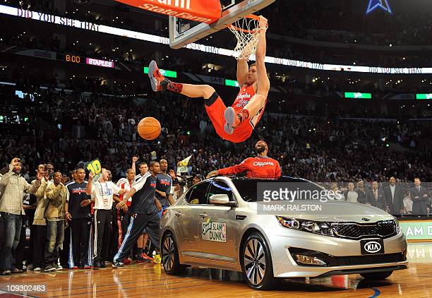 Blake Griffin from the LA Clippers slam dunks over a car with teammate Baron Davis inside before winning the AllStars Slam Dunk contest at the...