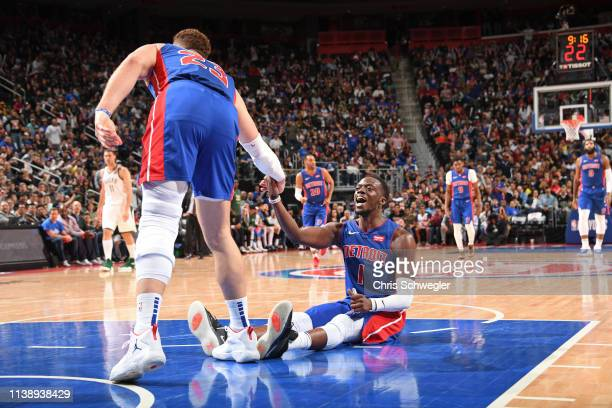 Blake Griffin helps up Reggie Jackson of the Detroit Pistons during Game Four of Round One of the 2019 NBA Playoffs against the Milwaukee Bucks on...