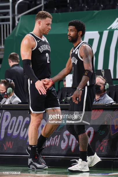 Blake Griffin hi-fives Kyrie Irving of the Brooklyn Nets during the game against the Milwaukee Bucks on May 4, 2021 at the Fiserv Forum Center in...