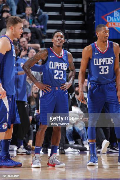 Blake Griffin Lou Williams and Wesley Johnson of the Los Angeles Clippers look on during the game against the Sacramento Kings on November 25 2017 at...