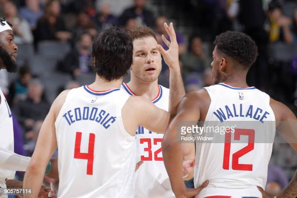 Blake Griffin Milos Teodosic and Tyrone Wallace of the Los Angeles Clippers talk during the game against the Sacramento Kings on January 11 2018 at...