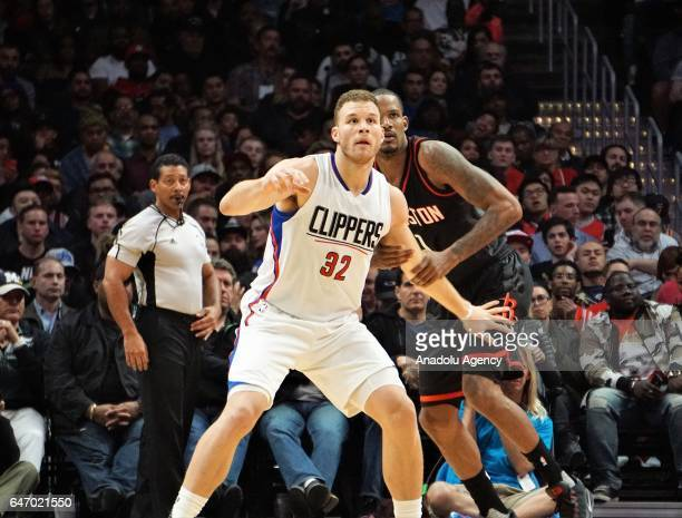 Blake Griffin of Los Angeles Clippers in action against Trevor Ariza of Houston Rockets during the NBA match between Los Angeles Clippers and Houston...