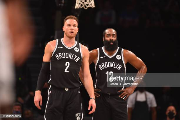 Blake Griffin of the Brooklyn Nets and James Harden of the Brooklyn Nets looks on during Round 2, Game 7 on June 19, 2021 at Barclays Center in...