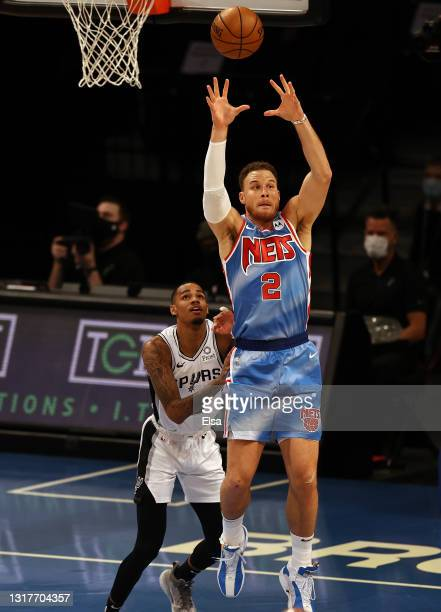 Blake Griffin of the Brooklyn Nets takes a pass as Dejounte Murray of the San Antonio Spurs defends in the first quarter at Barclays Center on May...
