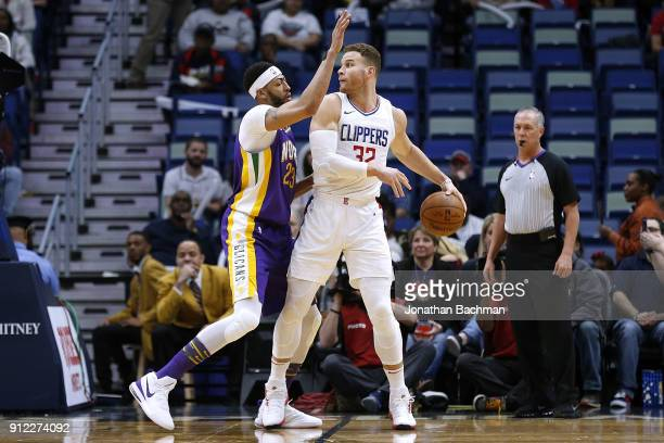 Blake Griffin of the LA Clippers drives against Anthony Davis of the New Orleans Pelicans druing the first half at the Smoothie King Center on...