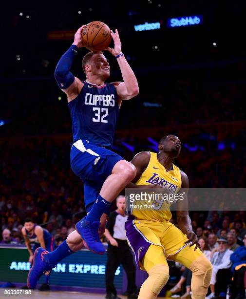 Blake Griffin of the LA Clippers drives to the basket over Luol Deng of the Los Angeles Lakers during the first half of the Los Angeles Lakers home...