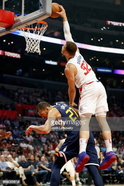 Blake Griffin of the LA Clippers dunks over Rudy Gobert of the Utah Jazz at the Staples Center on October 24 2017 in Los Angeles California