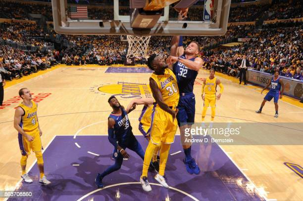 Blake Griffin of the LA Clippers dunks the ball against Julius Randle of the Los Angeles Lakers on October 19 2017 at STAPLES Center in Los Angeles...