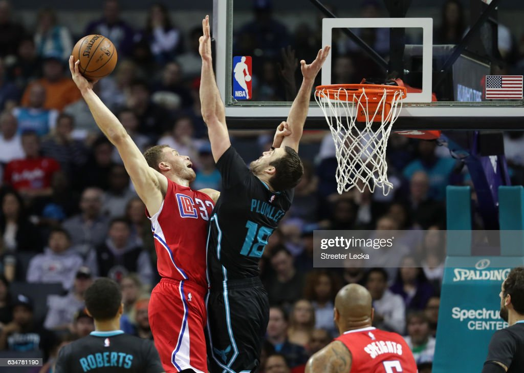 Blake Griffin #32 of the LA Clippers dunks the ball over Miles Plumlee #18 of the Charlotte Hornets during their game at Spectrum Center on February 11, 2017 in Charlotte, North Carolina.