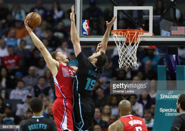 Blake Griffin of the LA Clippers dunks the ball over Miles Plumlee of the Charlotte Hornets during their game at Spectrum Center on February 11 2017...