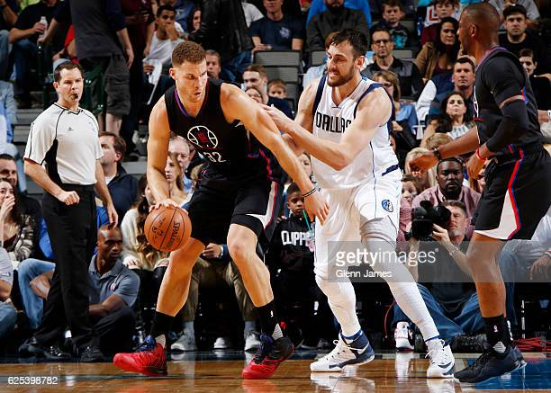 Blake Griffin of the LA Clippers handles the ball against Andrew Bogut of the Dallas Mavericks on November 23 2016 at the American Airlines Center in...