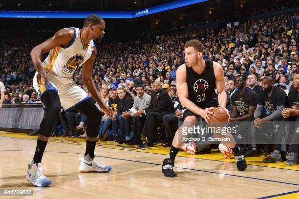 Blake Griffin of the LA Clippers handles the ball against Kevin Durant of the Golden State Warriors during the game on February 23 2017 at ORACLE...