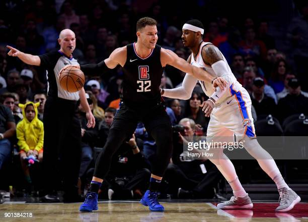 Blake Griffin of the LA Clippers posts up Carmelo Anthony of the Oklahoma City Thunder during a 127117 Thunder win over the LA Clippers at Staples...