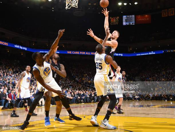 Blake Griffin of the LA Clippers shoots the ball against the Golden State Warriors during the game on February 23 2017 at ORACLE Arena in Oakland...