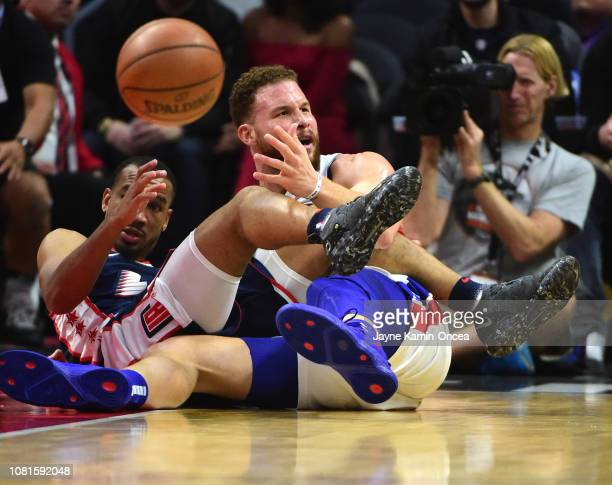 Blake Griffin of the Detroit Pistons and Avery Bradley of the Los Angeles Clippers get tangled up in the first half of the game at Staples Center on...