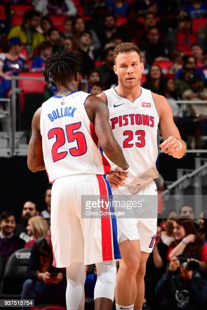 Blake Griffin of the Detroit Pistons and Reggie Bullock of the Detroit Pistons highfive during the game against the Chicago Bulls on March 24 2018 at...