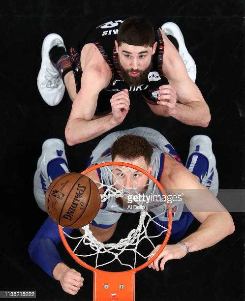 Blake Griffin of the Detroit Pistons battles for the ball with Joe Harris of the Brooklyn Nets during their game at Barclays Center on March 11 2019...