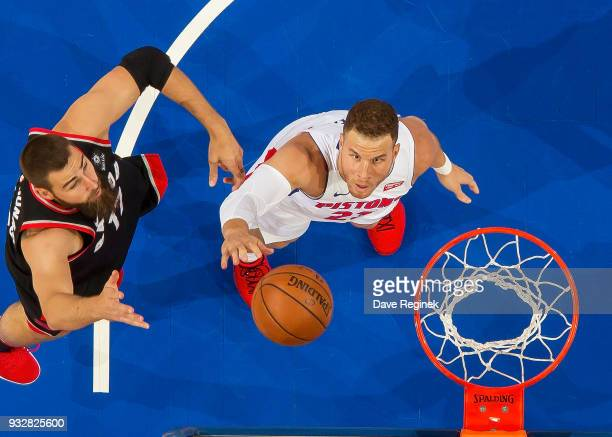 Blake Griffin of the Detroit Pistons battles for the rebound with Jonas Valanciunas of the Toronto Raptors in the first half of an NBA game at Little...