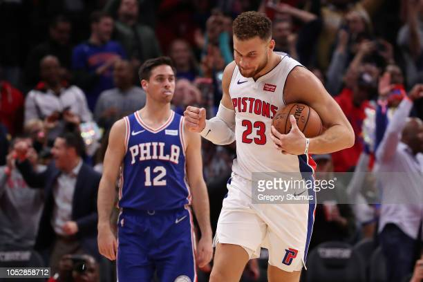Blake Griffin of the Detroit Pistons celebrates a 133132 overtime win over the Philadelphia 76ers at Little Caesars Arena on October 23 2018 in...