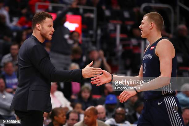 Blake Griffin of the Detroit Pistons celebrates with Henry Ellenson after a Toronto Raptors first half timeout at Little Caesars Arena on April 9...