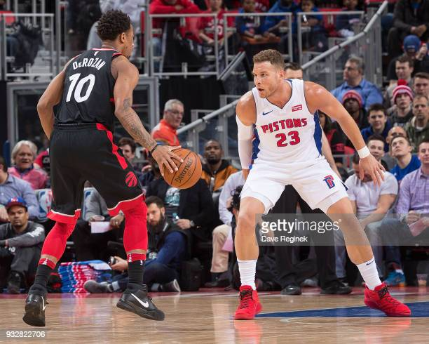 Blake Griffin of the Detroit Pistons defends against DeMar DeRozan of the Toronto Raptors in the first half of an NBA game at Little Caesars Arena on...