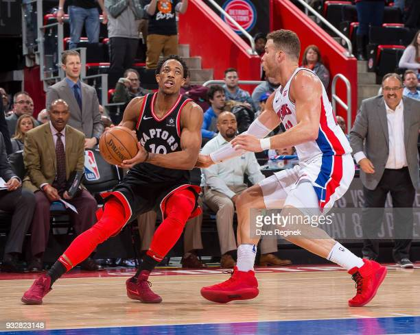 Blake Griffin of the Detroit Pistons defends against DeMar DeRozan of the Toronto Raptors during OT of an NBA game at Little Caesars Arena on March 7...