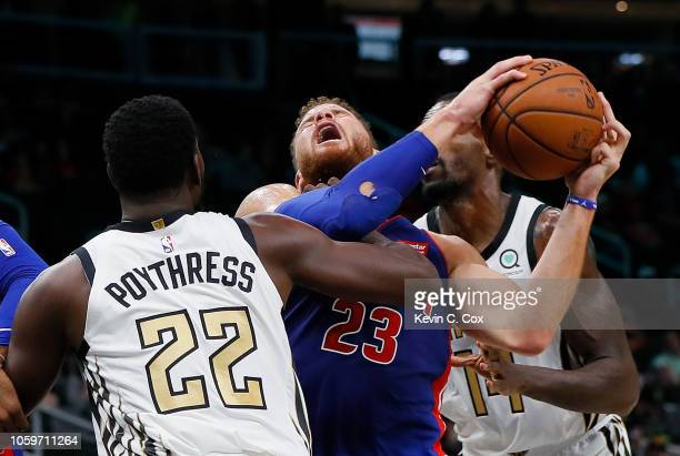 Blake Griffin of the Detroit Pistons draws a foul as he drives against Alex Poythress of the Atlanta Hawks at State Farm Arena on November 9 2018 in...