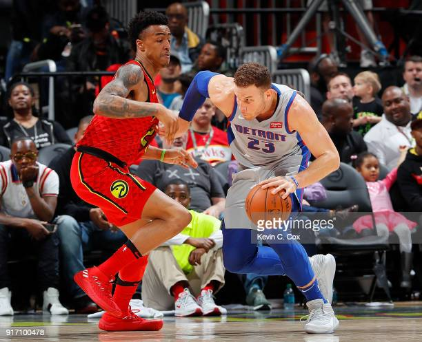 Blake Griffin of the Detroit Pistons drives against John Collins of the Atlanta Hawks at Philips Arena on February 11 2018 in Atlanta Georgia NOTE TO...