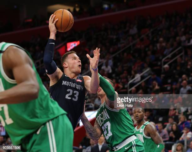 Blake Griffin of the Detroit Pistons drives the ball to the basket as Daniel Theis of the Boston Celtics defends during the second quarter of the...