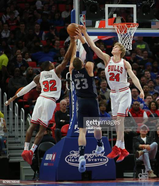 Blake Griffin of the Detroit Pistons drives the ball to the basket as Kris Dunn and Lauri Markkanen of the Chicago Bulls defend during the first half...
