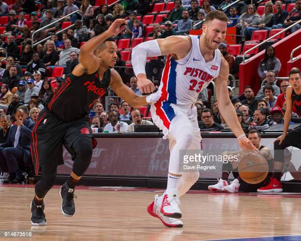 Blake Griffin of the Detroit Pistons drives to the basket in front of CJ McCollum of the Portland Trail Blazers during the an NBA game at Little...