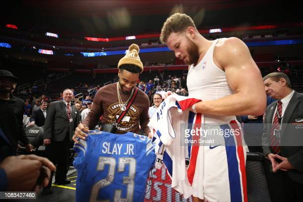 Blake Griffin of the Detroit Pistons exchanges jerseys after the game with Darius Slay Jr of the Detroit Lions on January 16 2019 at Little Caesars...