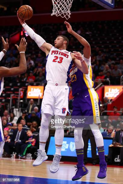 Blake Griffin of the Detroit Pistons grabs a rebound next to Anthony Davis of the New Orleans Pelicans during the first half at Little Caesars Arena...