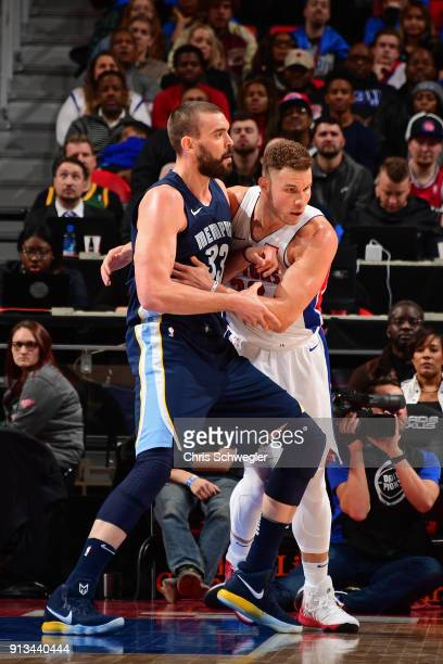 Blake Griffin of the Detroit Pistons guards Marc Gasol of the Memphis Grizzlies on February 1 2018 at Little Caesars Arena in Detroit Michigan NOTE...
