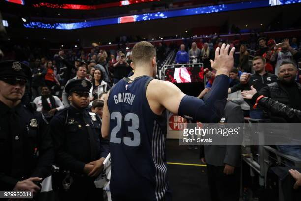 Blake Griffin of the Detroit Pistons high fives fans after the game against the Chicago Bulls on MARCH 9 2018 at Little Caesars Arena in Detroit...