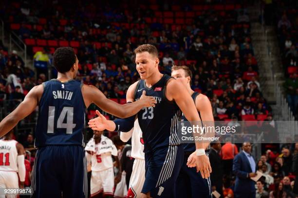Blake Griffin of the Detroit Pistons high fives Ish Smith of the Detroit Pistons against the Chicago Bulls on March 9 2018 at Little Caesars Arena in...