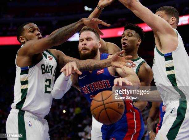Blake Griffin of the Detroit Pistons is defended by Sterling Brown Giannis Antetokounmpo and Brook Lopez of the Milwaukee Bucks while going to the...