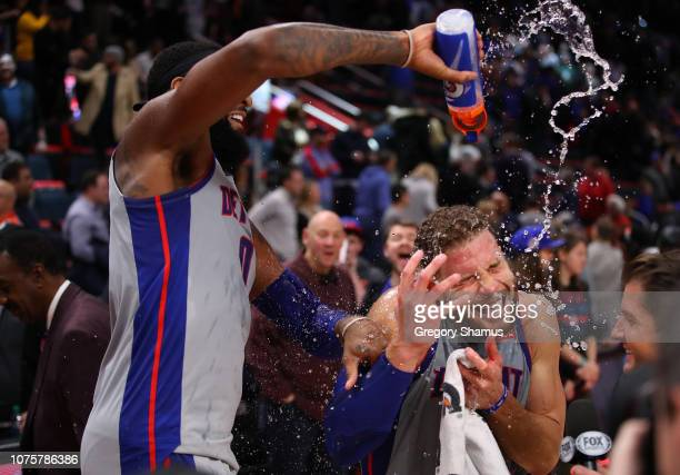 Blake Griffin of the Detroit Pistons is showered with water by Andre Drummond after a 11102 win over the Golden State Warriors at Little Caesars...
