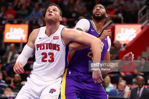 Blake Griffin of the Detroit Pistons looks for a rebound next to Anthony Davis of the New Orleans Pelicans during the first half at Little Caesars...