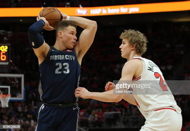 Blake Griffin of the Detroit Pistons looks to drive the ball to the basket as Lauri Markkanen of the Chicago Bulls defends during the second half of...