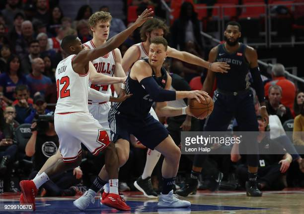 Blake Griffin of the Detroit Pistons looks to make a pass as Kris Dunn of the Chicago Bulls defends during the first half of the game at Little...