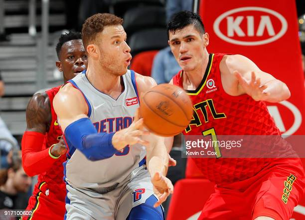 Blake Griffin of the Detroit Pistons passes the ball against Dennis Schroder and Ersan Ilyasova of the Atlanta Hawks at Philips Arena on February 11...